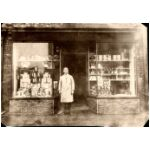 William John PrestonHarrison outside his shop