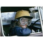 Nicks sister Sal in the family car wearing her Dad's work gear just shows the sort of child she was, full of mischief